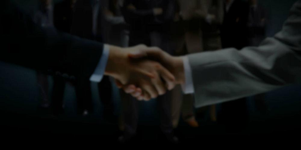 bg_blurred_handshake